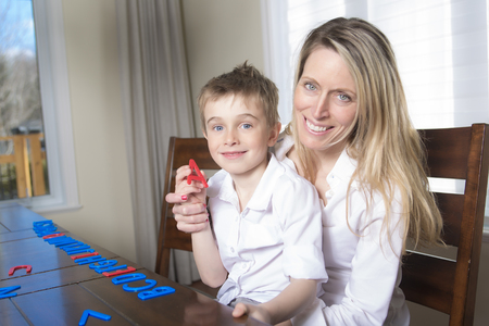 developmental: Mother and son at home play together. The idea and concept of the school, school, home education and developmental activities. Stock Photo