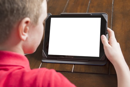 blank tablet: A Child holding white tablet PC in hands Stock Photo