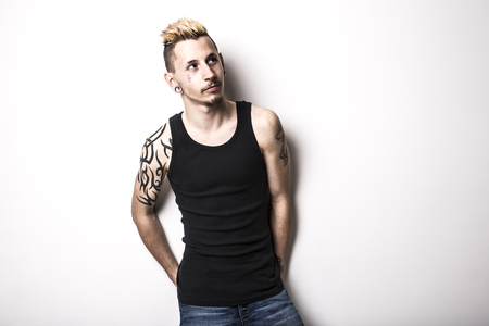 A Handsome stylish young man with tattoo and piercing Stock Photo