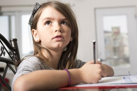 A Teenage girl doing homework for school.