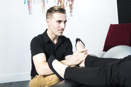 osteopath: A Osteopath doing reflexology massage on female foot