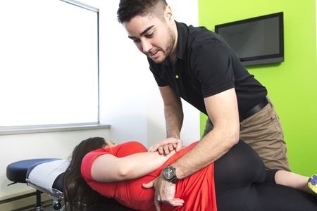 mobilization: A Physical therapist doing mobilisation of the spine
