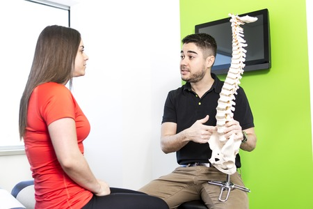 osteopath: A Female Patient Describing talk to Injury To Osteopath