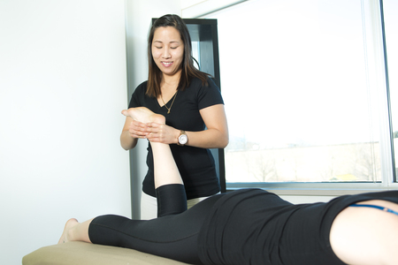 hardening: A Patient at the physiotherapy doing physical exercises with his therapist