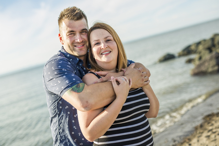 A portrait of living young couple at the beach Stock Photo