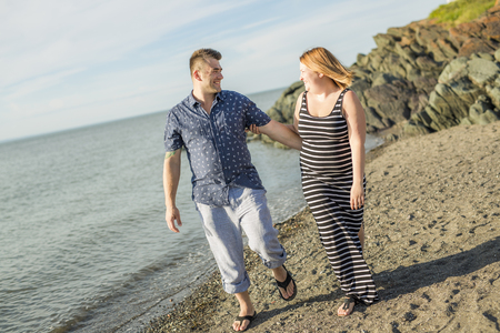 30 years old married couple: A portrait of living young couple at the beach Stock Photo