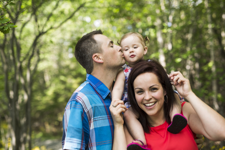A Family with Cute Baby girl Nature in the Forest