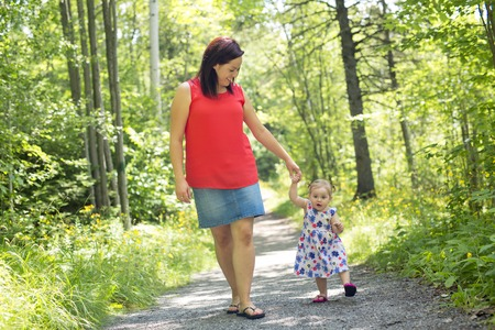 A Mother and daughter in forest having fun Stock Photo