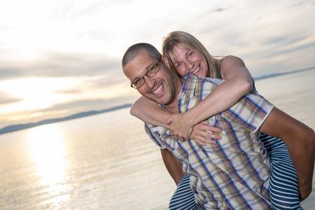 A portrait of living young couple at the beach Banco de Imagens