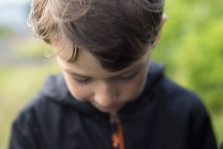 depress: A Portrait of happy boy blur and depress effect