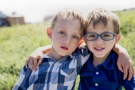 Two Children Together In field having fun Stock Photo
