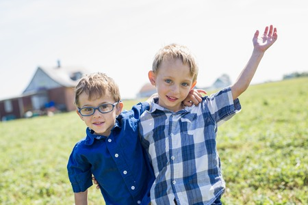 4 5 year old: Two Children Together In field having fun Stock Photo