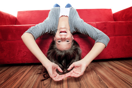 legs up: A Smiling woman with legs up on couch in living room