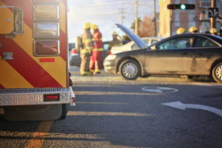 intubation: An accident scene on the road of a city with ambulance and fire fighter.