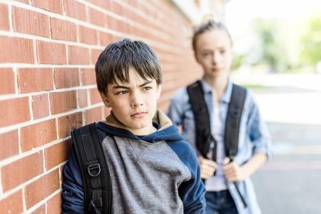 Portrait of school 10 years boy and girl having fun outside Stock Photo