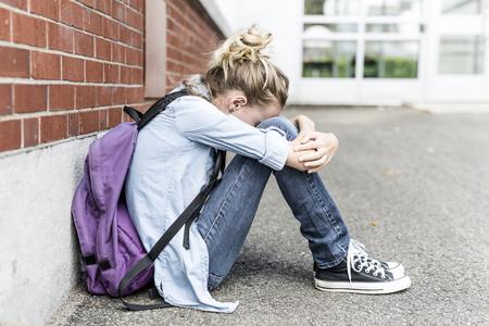 A Unhappy depress Pre teen girl at school