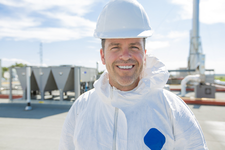 A professional in protective uniform, in the roof for cleaning