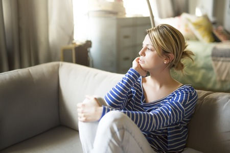 woman sitting on the couch take some good time