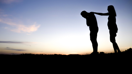 Sad young man silhouette worried at sunset Stock Photo