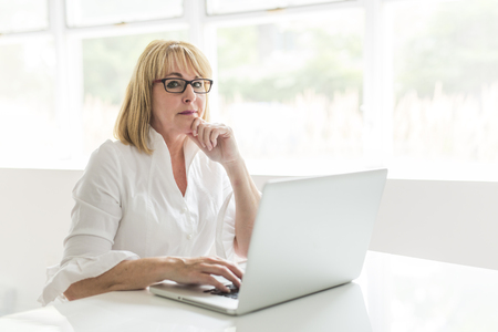 mature woman using laptop at home