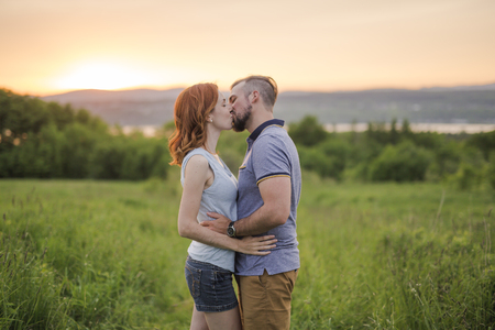 africa kiss: Young couple enjoying the sunset in the meadow