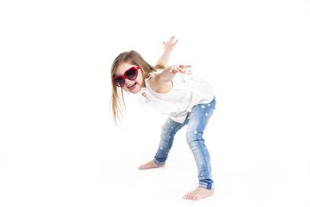 Little girl with love glasses on studio white background