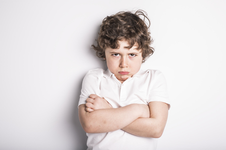 Head and Shoulders Close Up Portrait of Young boy with Sulk attitude Stock Photo