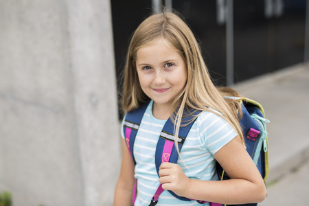 nine years old girl student at school
