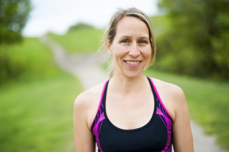 portrait of a woman jogging outdoors Stock Photo