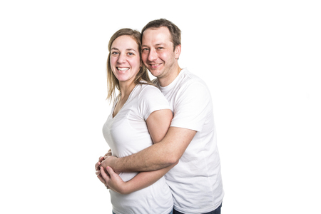 A happy couple isolated on white background. Attractive man and woman being playful.