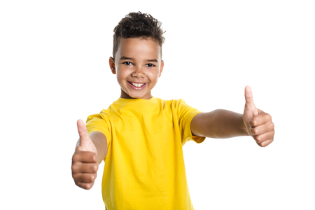 Adorable african boy on studio white background