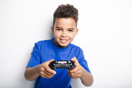 young child having fun playing video games Stock Photo