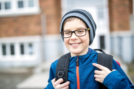 Elementary school pupil outside with rucksack
