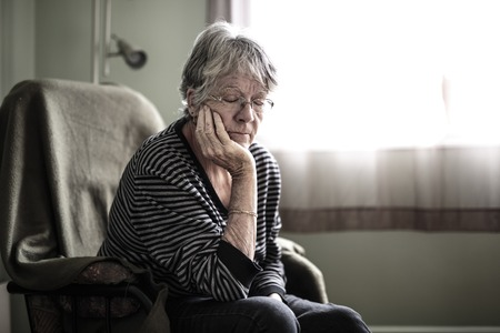 worried senior woman at home felling very bad Stock Photo