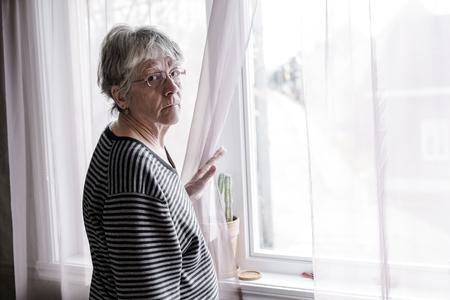 worried senior woman at home felling very bad Stok Fotoğraf