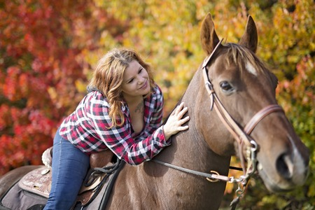Beautiful and natural adult woman outdoors with horse Archivio Fotografico
