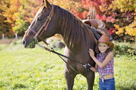 Autumn season young girl and horse Stock Photo