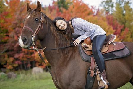 Beautiful girl with black hair   horse 写真素材