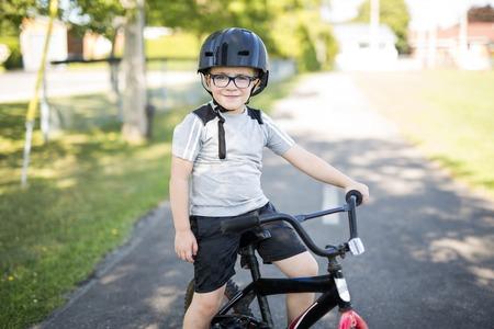 six year old boy biking in the park
