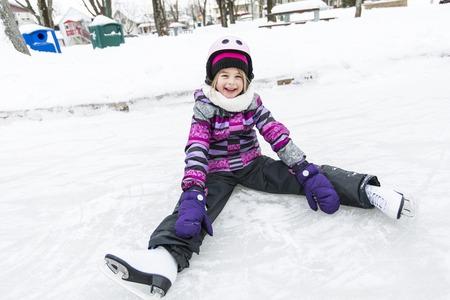 A little girl enjoying ice skating in winter season Imagens
