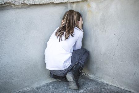 校庭に6歳の学校の女の子 写真素材