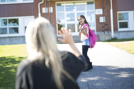 grader: Mother daughter saying her goodbye for the day Stock Photo
