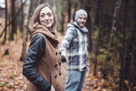 Couple in the autumn park Stock Photo