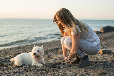 portrait of beautiful girl pretty white West Highland dog