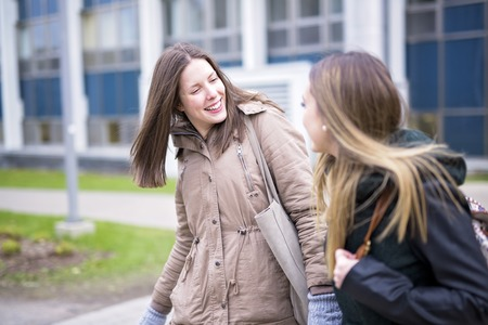 beautiful teenage students together outside in the school Stock Photo