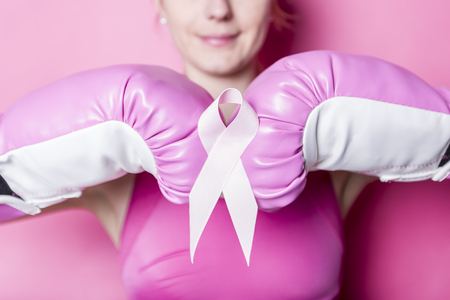 Fight for Breast Cancer woman with symbol on pink background