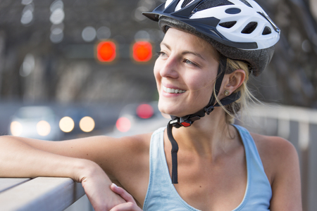 Young Woman Riding Bike outside Stock Photo