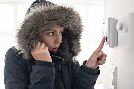 Woman With Warm Clothing Feeling The Cold Inside House