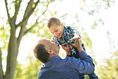 grandfather and littleson having fun in the park