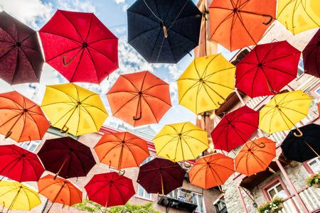 Lot of Umbrellas in Petit Champlain street Quebec city, Canada Фото со стока